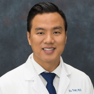 Asian male doctor smiling named Vu Tran, MD.